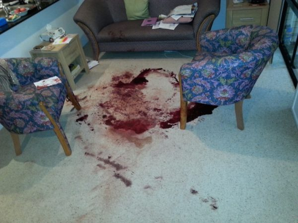 Crime Sceners with Blood on the Floor in a living room