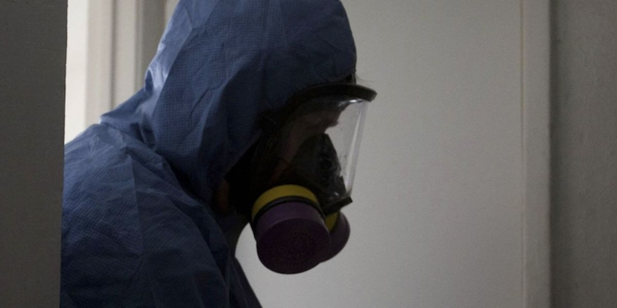 Bioremediation technician cleaning suicide cleaning scene